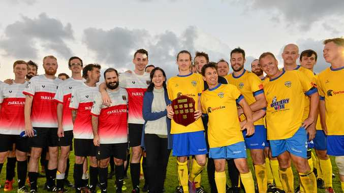 IN HIS HONOUR: The Caloundra and Kawana Football Clubs unite for the inaugural Lachlan Wells Charity Shield match. Lachlan's aunt Kristine Hanna (centre) spoke on the family's behalf.