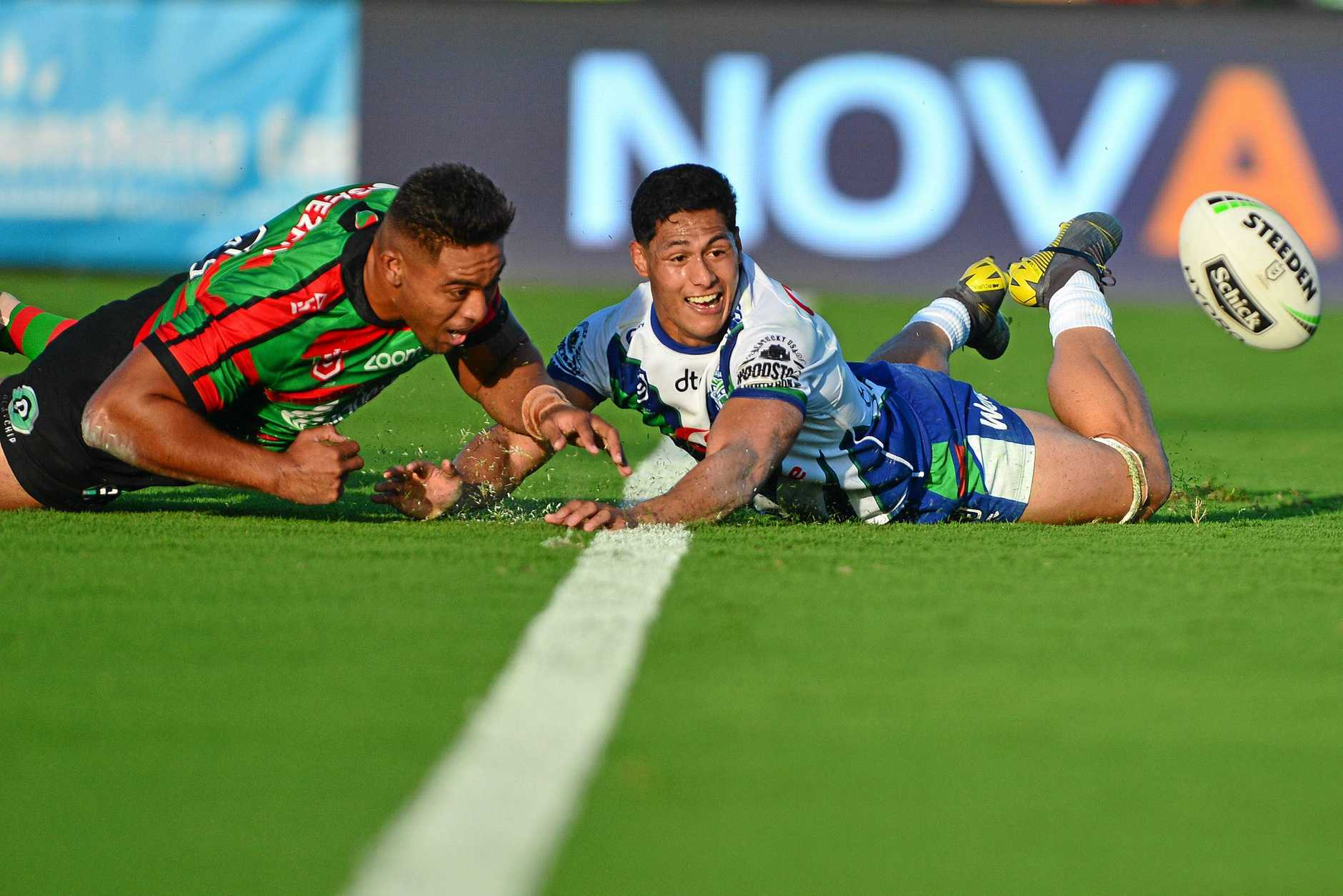 NRL action at Sunshine Coast Stadium between New Zealand Warriors and the South Sydney Rabbitohs. Junior Tatola and Roger Tuivasa-Sheck.