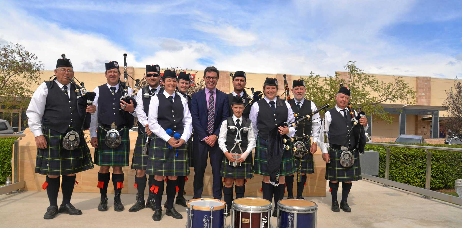 Members of the Warwick Thistle Pipe Band with Member for Maranoa David Littleproud at the dedication of the memorial wall and dais in Leslie Park.