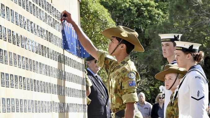 LEST WE FORGET: Navid Alan of 13 Army Cadet Unit unveils the first plaque as members of the unveiling party (front to back) CDT AB Angelina Poulter, Hannah Clutterbuck 13 ACU and CDT LS Harrison Lee watch on at the Anzac Memorial Service at Toowoomba Garden of Remembrance.