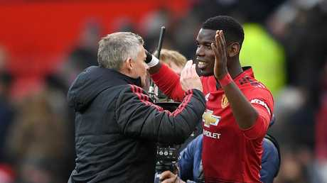 Ole Gunnar Solskjaer with Paul Pogba after the victory. Picture: Getty
