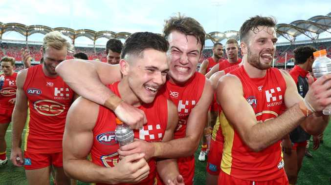 Gold Coast celebrates its last-gasp win over Carlton. Picture: Chris Hyde/Getty Images.