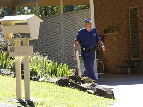 Police in the driveway of the house in Kendall where William vanished. Picture: David Moir.
