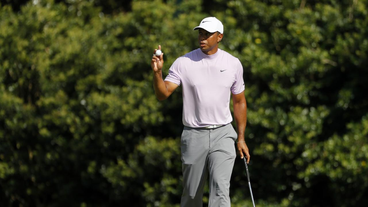 AUGUSTA, GEORGIA - APRIL 13: Tiger Woods of the United States acknowledges patrons after putting on the 11th green during the third round of the Masters at Augusta National Golf Club on April 13, 2019 in Augusta, Georgia. (Photo by Kevin C. Cox/Getty Images)
