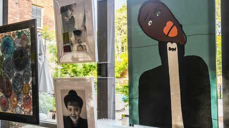 Elisa and Martin Manrique (pictured in the frames) were talented young artists. Elisa's painting of singer Jason Derulo is on the right. St Lucy's school held an exhibition that include their work.