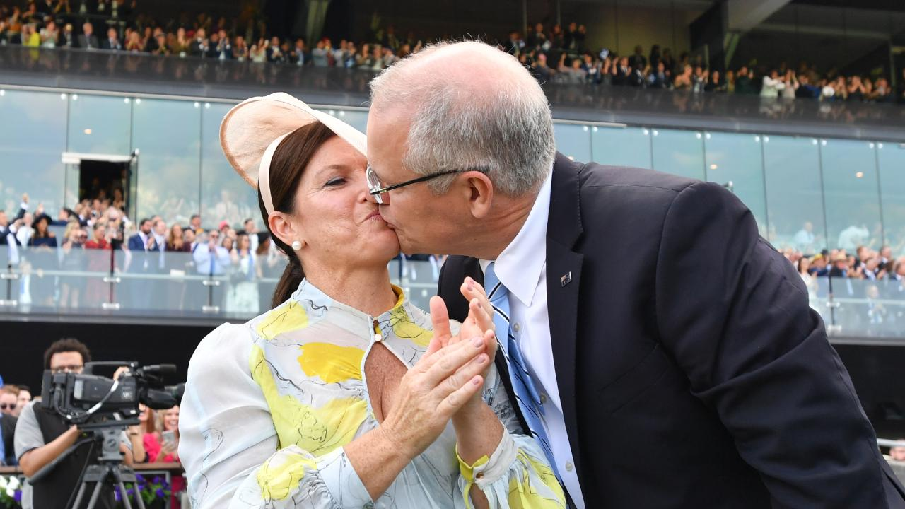 Prime Minister Scott Morrison kisses wife Jenny after watching champion racehorse Winx win.