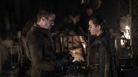 Joe Dempsie as Gendry and Maisie Williams as Arya Stark in a scene from Game of Thrones.