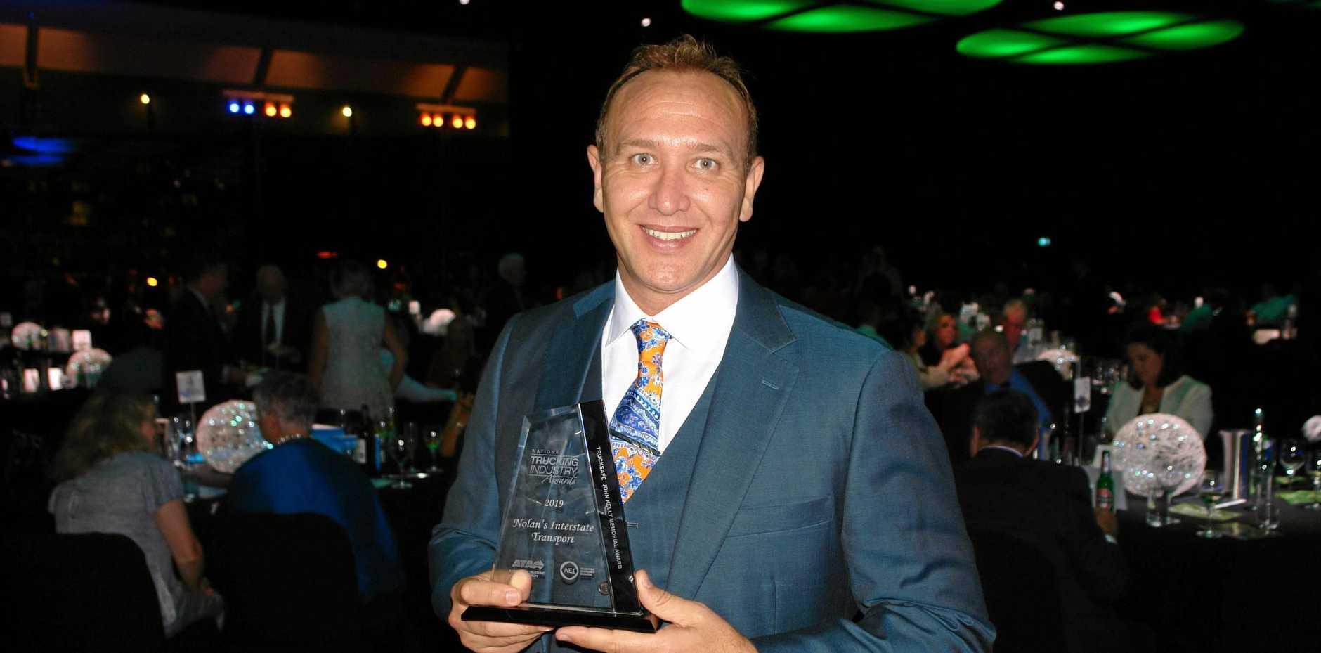 HONOUR: Darren Nolan accepts the TruckSafe John Kelly Award on behalf of his team.
