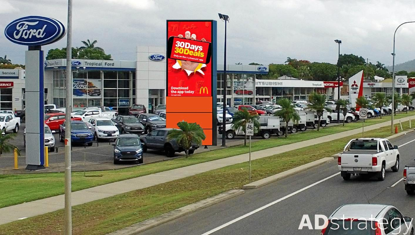BIGGER'S BETTER: Rockhampton small businessman, Paul Sweeney (INSET) is the man behind the biggest automotive industry sign site in Australia on Moores Creek Rd.