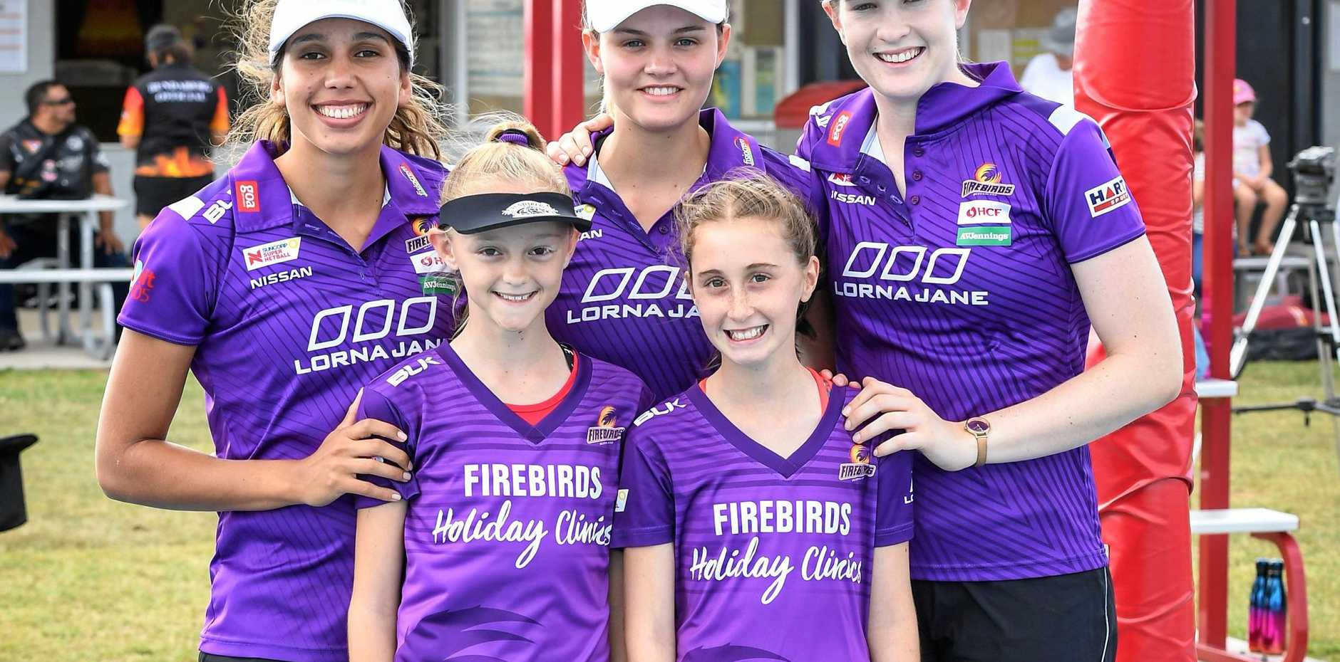 ALL SMILES: Queensland Firebirds players Jemma Mi Mi, Tippah Dwan and Tara Hinchliffe meet two of their biggest fans, Caitlyn Weston and Elisabeth Pitt.
