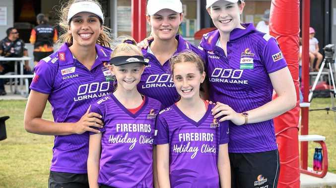 ALL SMILES: Queensland Firebirds players Jemma Mi Mi, Tippah Dwan and Tara Hinchliffe meet two of their biggest fans, Caitlyn Weston and Elisabeth Pitt.