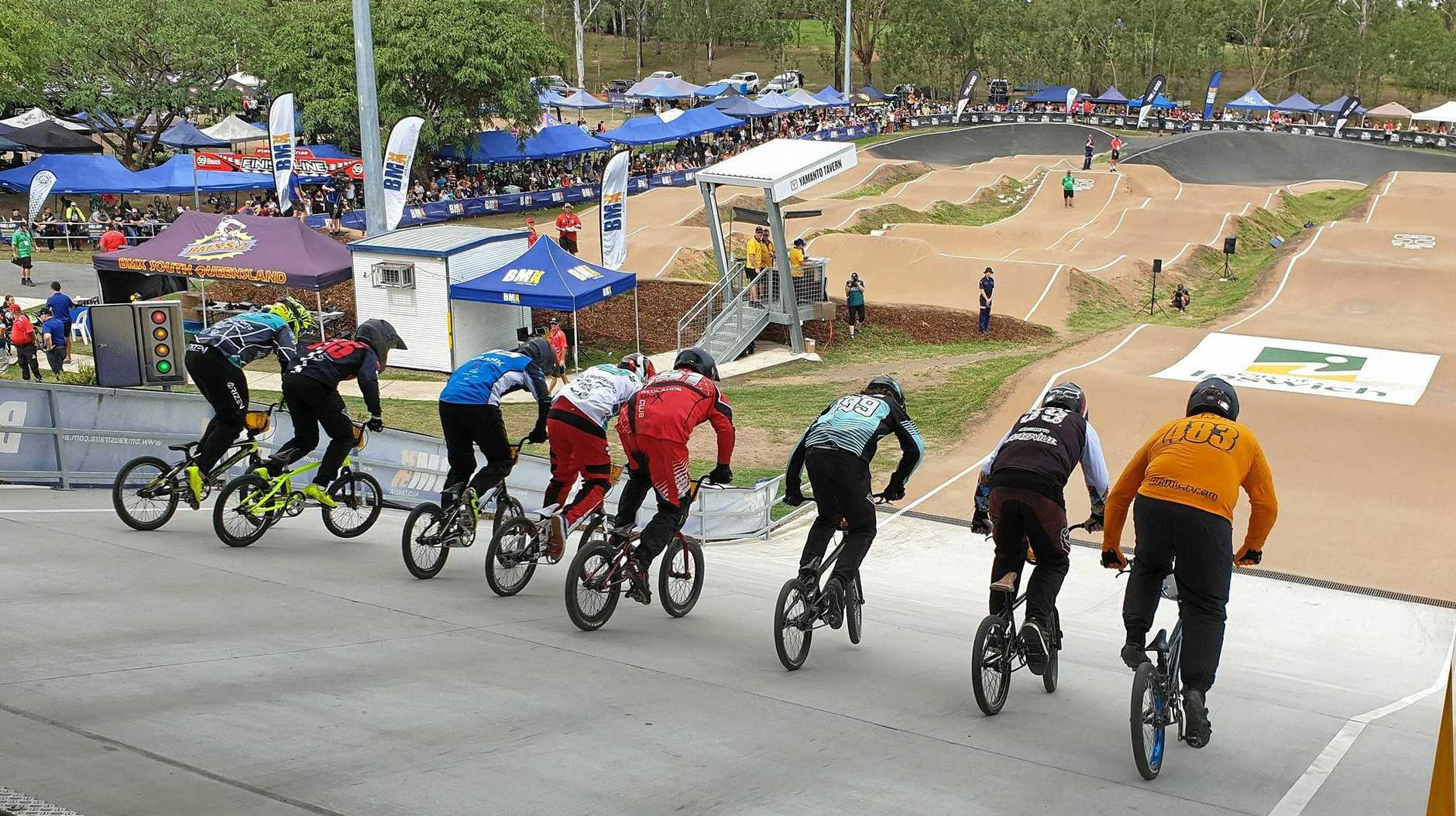 SPECTACULAR SCENE: Riders prepare to tackle the Ipswich and West Moreton BMX Club circuit during the third round of the national BAD BOY series.