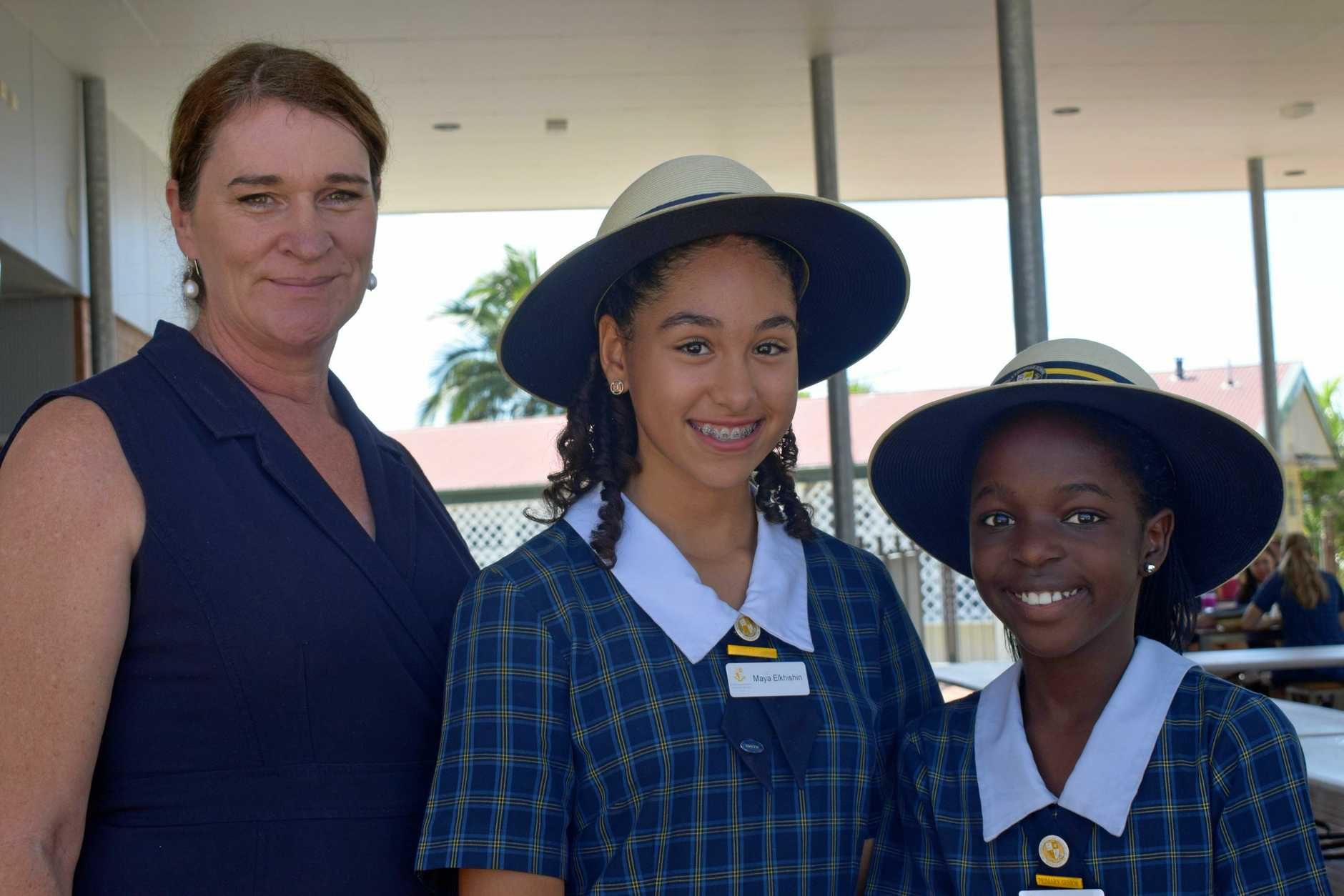 SUPPORTING FARMERS: Principal of Rockhampton Girls Grammar School Christine Hills, with grade six students Maya Elkhishin and Carrie Mtize.
