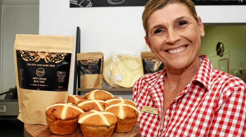 Artizan Bakery owner Simone Lawrie with gluten free hot cross buns.