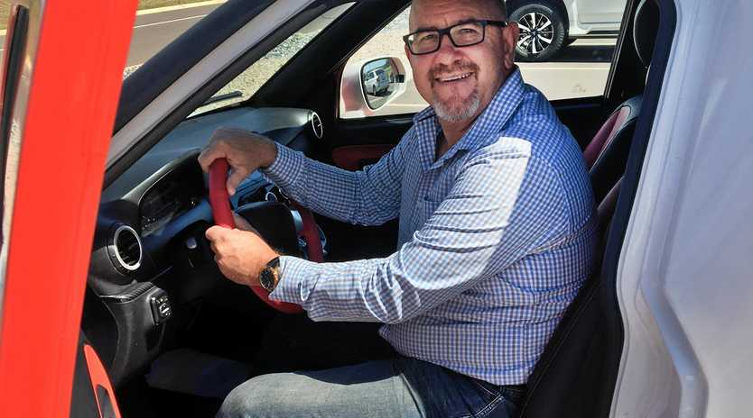 GREAT RIDE: Fraser Coast Regional Council CEO Ken Diehm takes the ACE Cargo Van, Australia's first manufactured electric vehicle, for a drive.