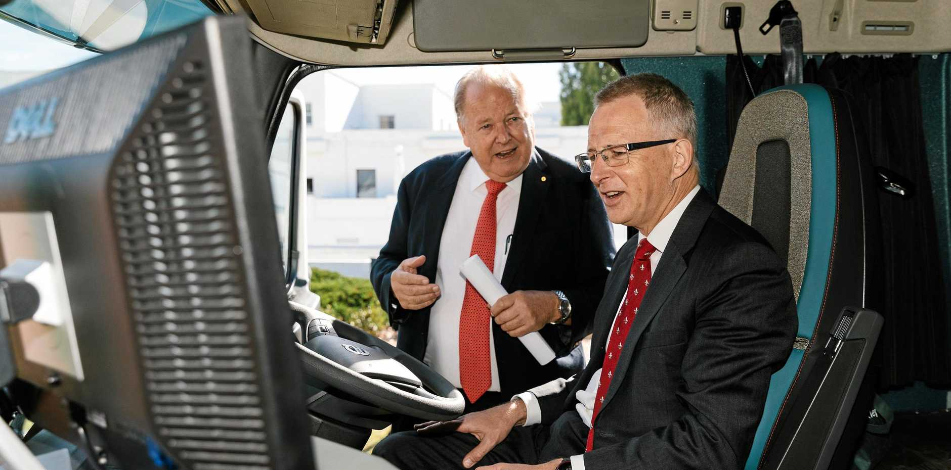SAFETY FIRST: Ron Finemore gives former Minister for Urban Infrastructure and Cities Paul Fletcher a demonstration of Seeing Machines' fatigue management system.