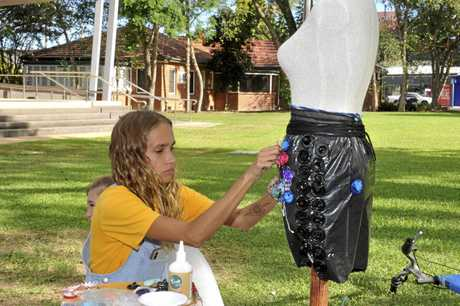 Rayshell Strong working on a condom couture as part of Clarence Valley Youth Week at Market Square.