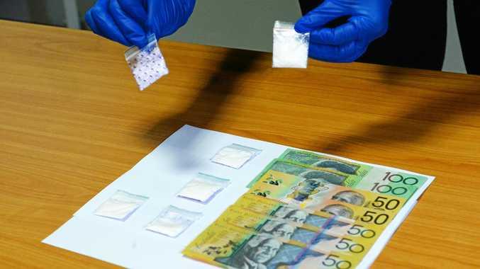 Cocaine and cash seized during arrest at Rockhampton Airport.