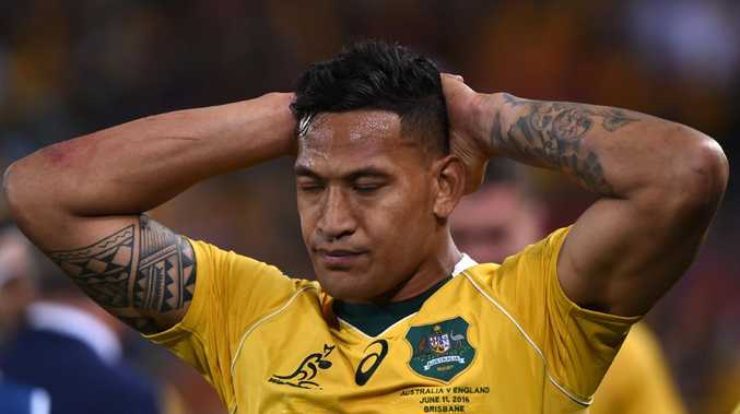 Wallabies player Israel Folau reacts following the First Test between the Australia Wallabies and the England Roses at Suncorp Stadium in Brisbane, Saturday, June 11, 2016. (AAP Image/Dave Hunt) NO ARCHIVING, EDITORIAL USE ONLY