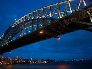 Man climbs Harbour Bridge in Iran protest