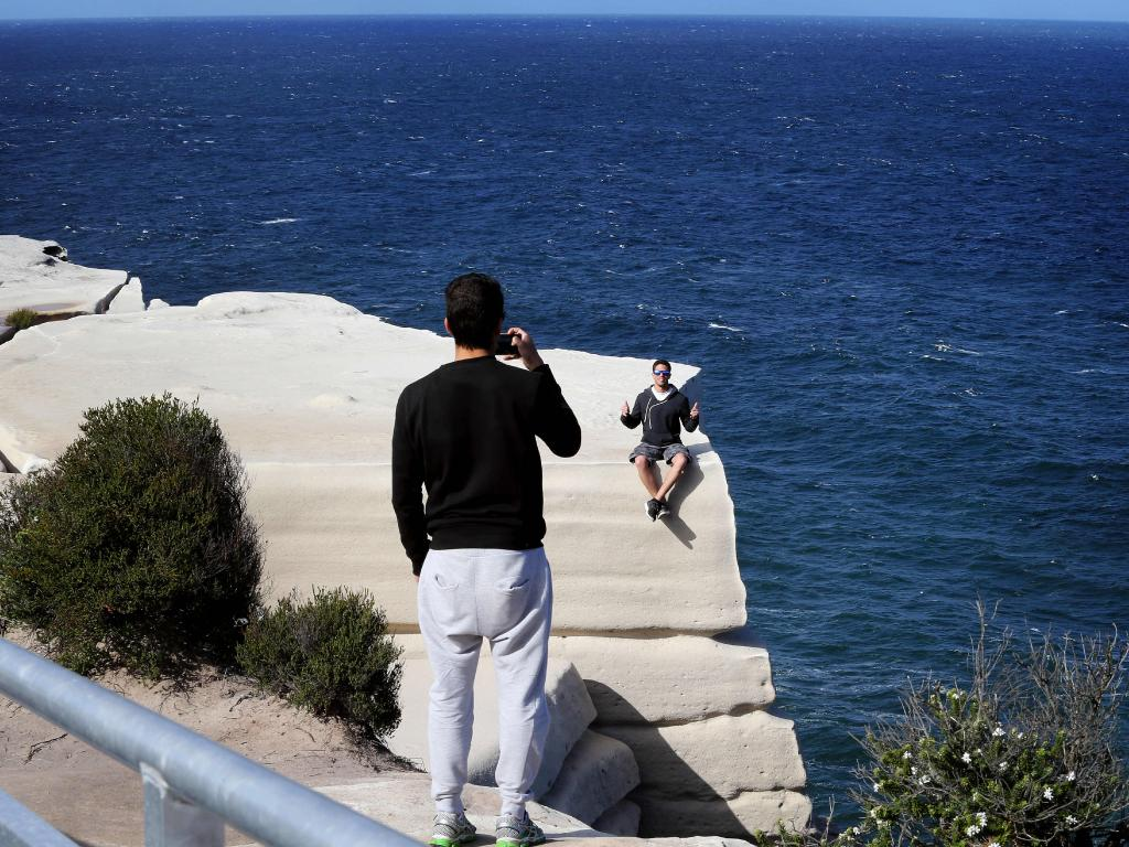 Insta-famous spots like Wedding Cake Rock, south of Sydney, have created headaches for local authorities as visitors take risks for the perfect photo. Picture: John Feder