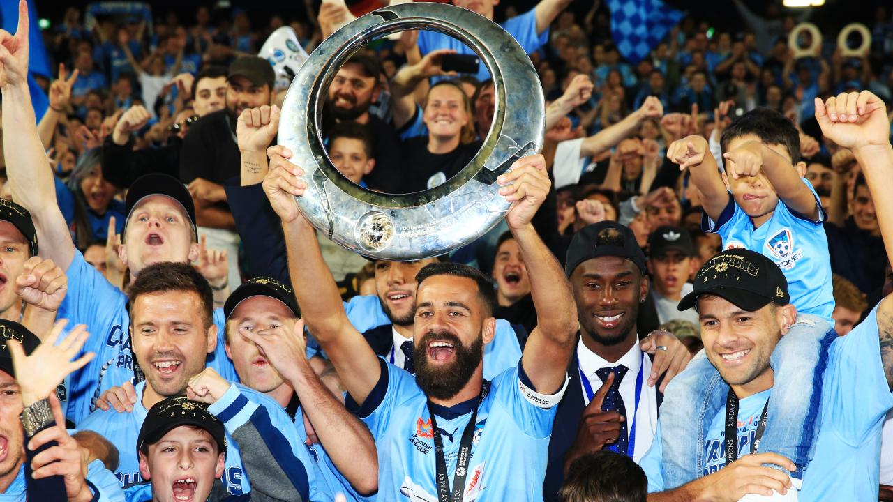 Alex Brosque holds up the A-League trophy after Sydney FC won the 2017 grand final. Picture: Mark Evans