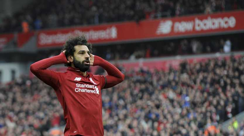 Mohamed Salah celebrates his stunning goal at Anfield. Picture: AP