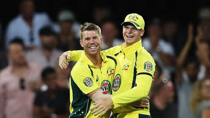Australia's David Warner celebrates with Steve Smith. Picture: Brett Costello