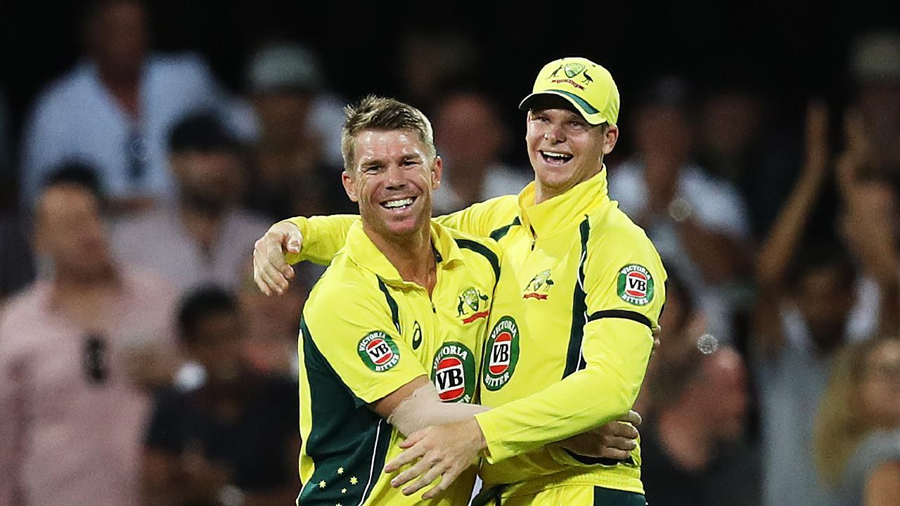 Australia's David Warner celebrates with Steve Smith. Picture: Brett Costello