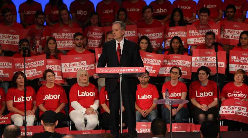 Bill Shorten speaks at a volunteers rally in front of red Labor banners, in the style of American campaigning. Picture: Kym Smith