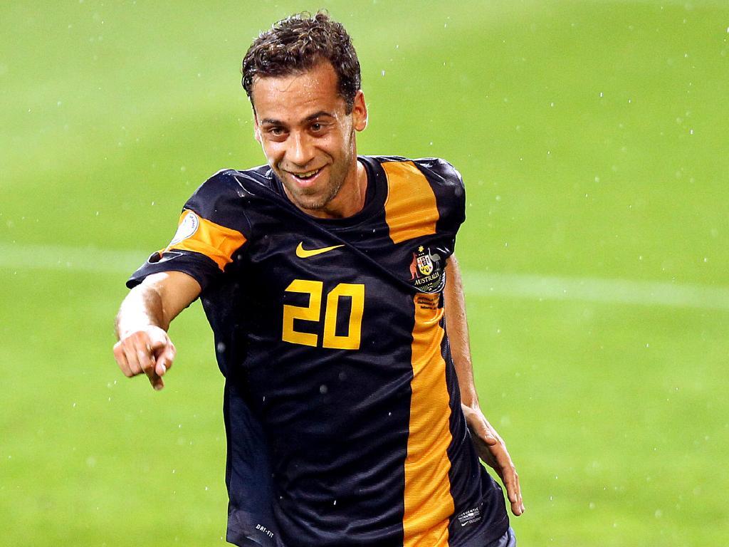 Brosque celebrates scoring for the Socceroos against Saudi Arabia in 2012.