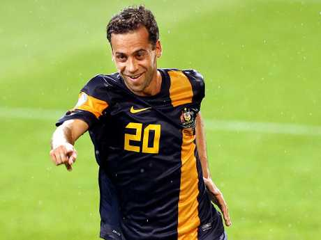 Brosque celebrates scoring for the Socceroos against Saudi Arabia in 2012.