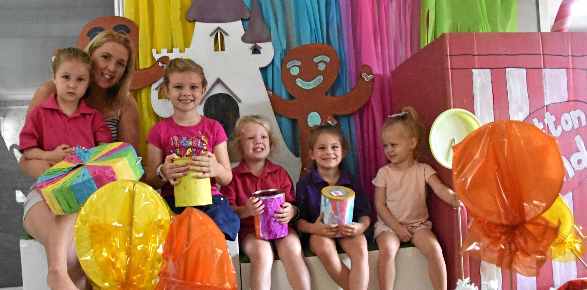 Jess Kirk, Maya Kirk, Bridie Kirk, Bianca Robson, Avalee Simpson and Tenlee Simpson with part of the Birralee Kindergarten 'candy land' float.