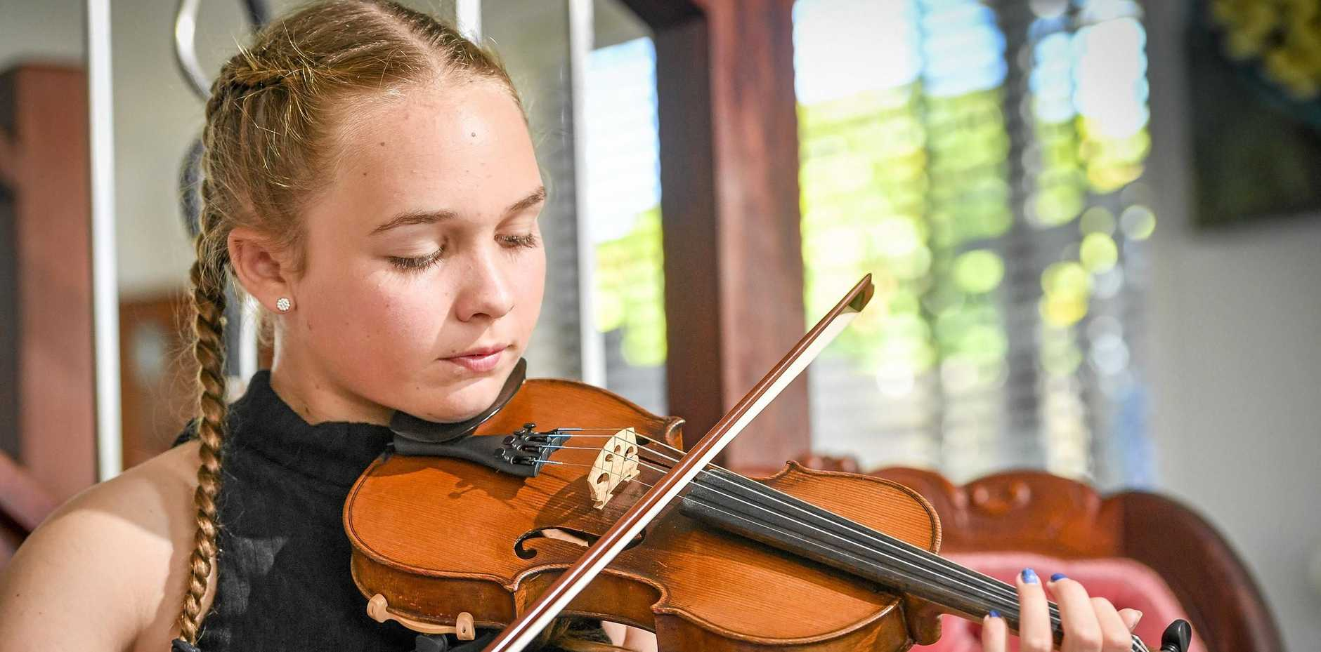ANTIQUE PRIZE: Boyne Island teenager Talia Clow won Simply For Strings' aspiring musicians award, and received a 120-year-old violin to use for 12 months.