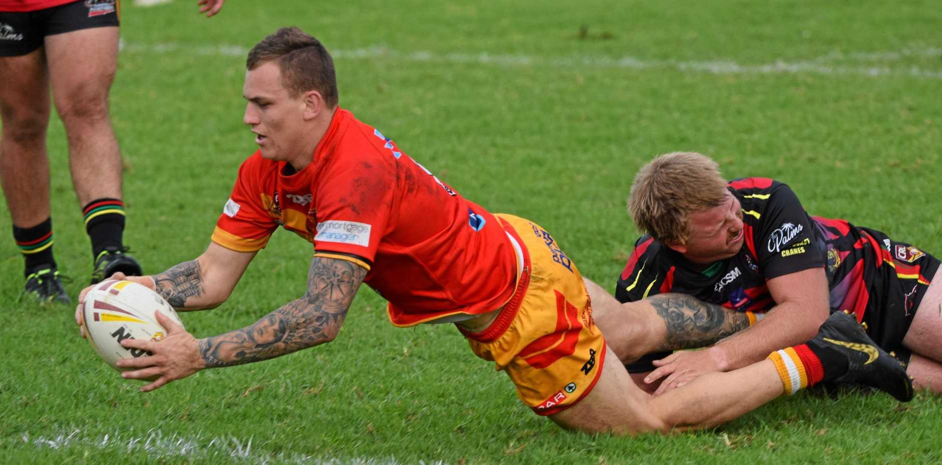 TRY TIME: Coffs Harbour Comets second rower Brad Collinson dives over for a try against the Sawtell Panthers on Sunday.