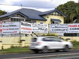 Council takes action on signs claiming corruption, fraud