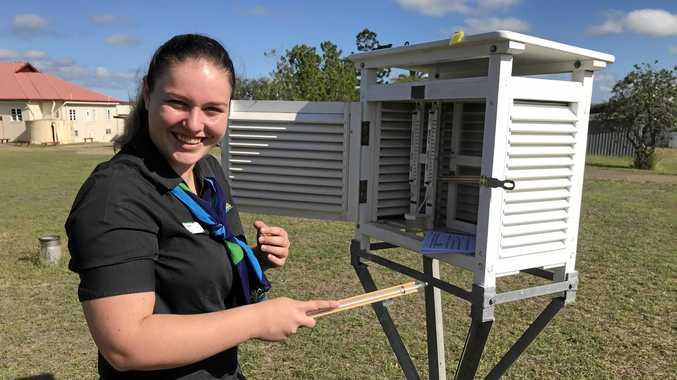 WEATHER WOMAN: NBRCs Simone King taking measurements inside the Stevenson Screen.