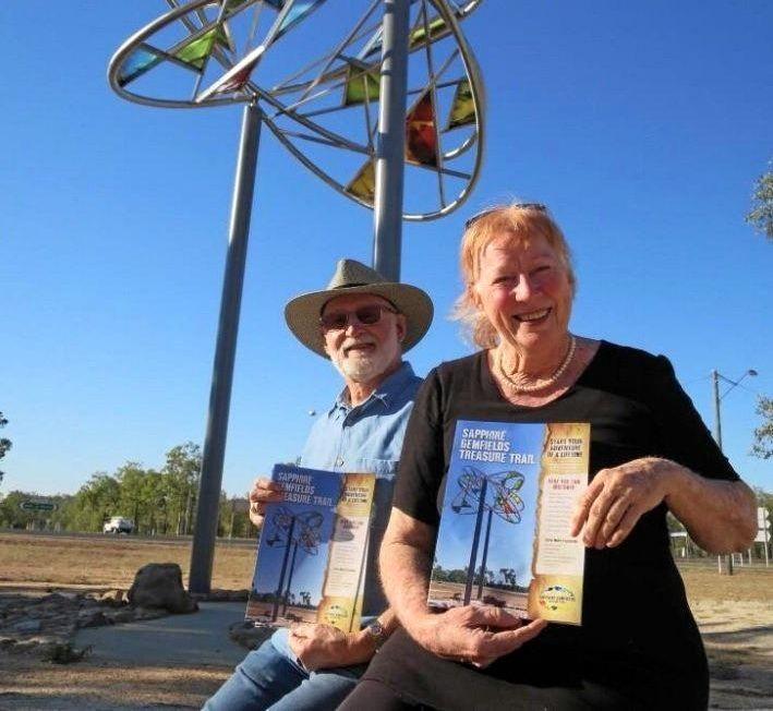 TREASURE TRAIL: Steering Committee Members Peter Brown and Jan Ward with the new Sapphire Gemfields Treasure Trail brochure.