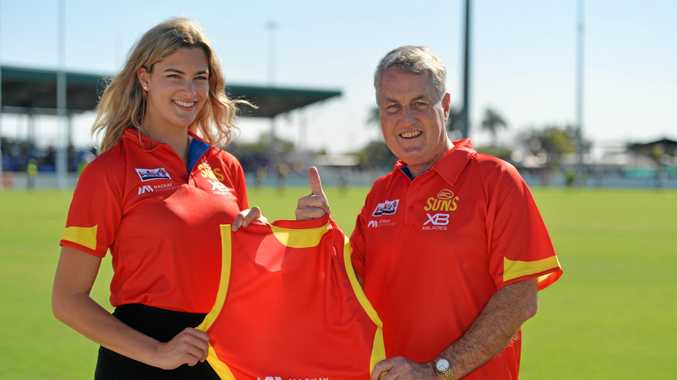 Gold Coast Suns' and Bakers Creek local Lauren Bella with Mayor Greg Williamson