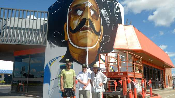 Out There Co. artists Jon Watson, Luke and Bill Gannon create the Harry MiMi mural on Gladstone Road
