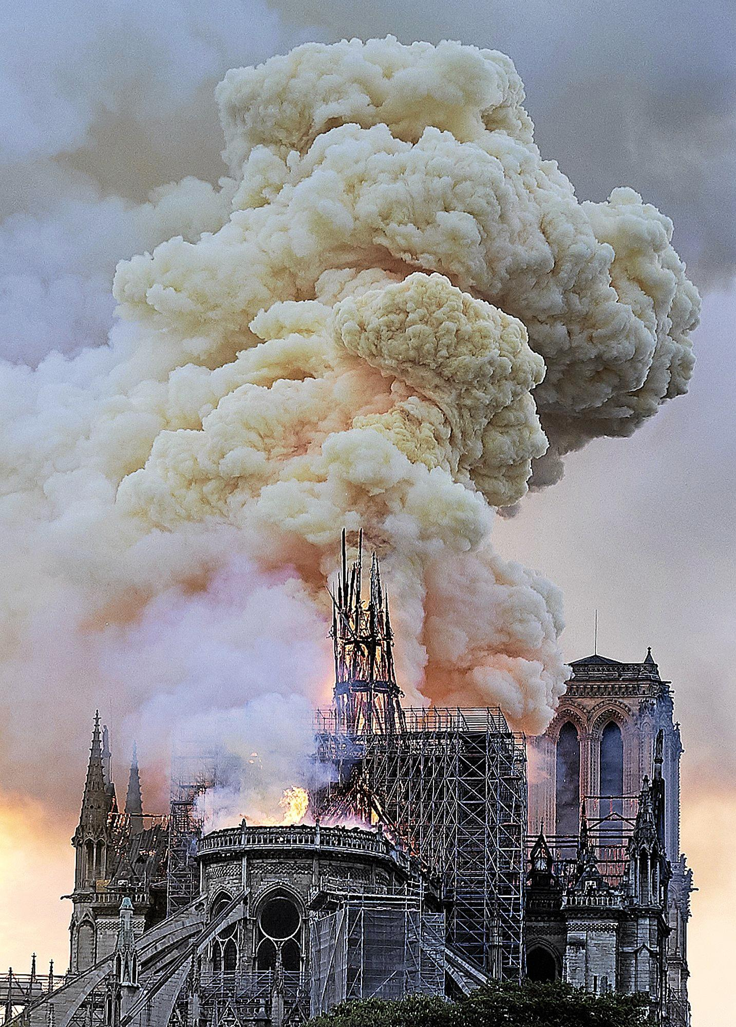 UTTER DISASTER: Flames and smoke rise as the spire on Notre Dame Cathedral collapses in Paris. INSET: Gympie chef Jacques Martin says the fire is