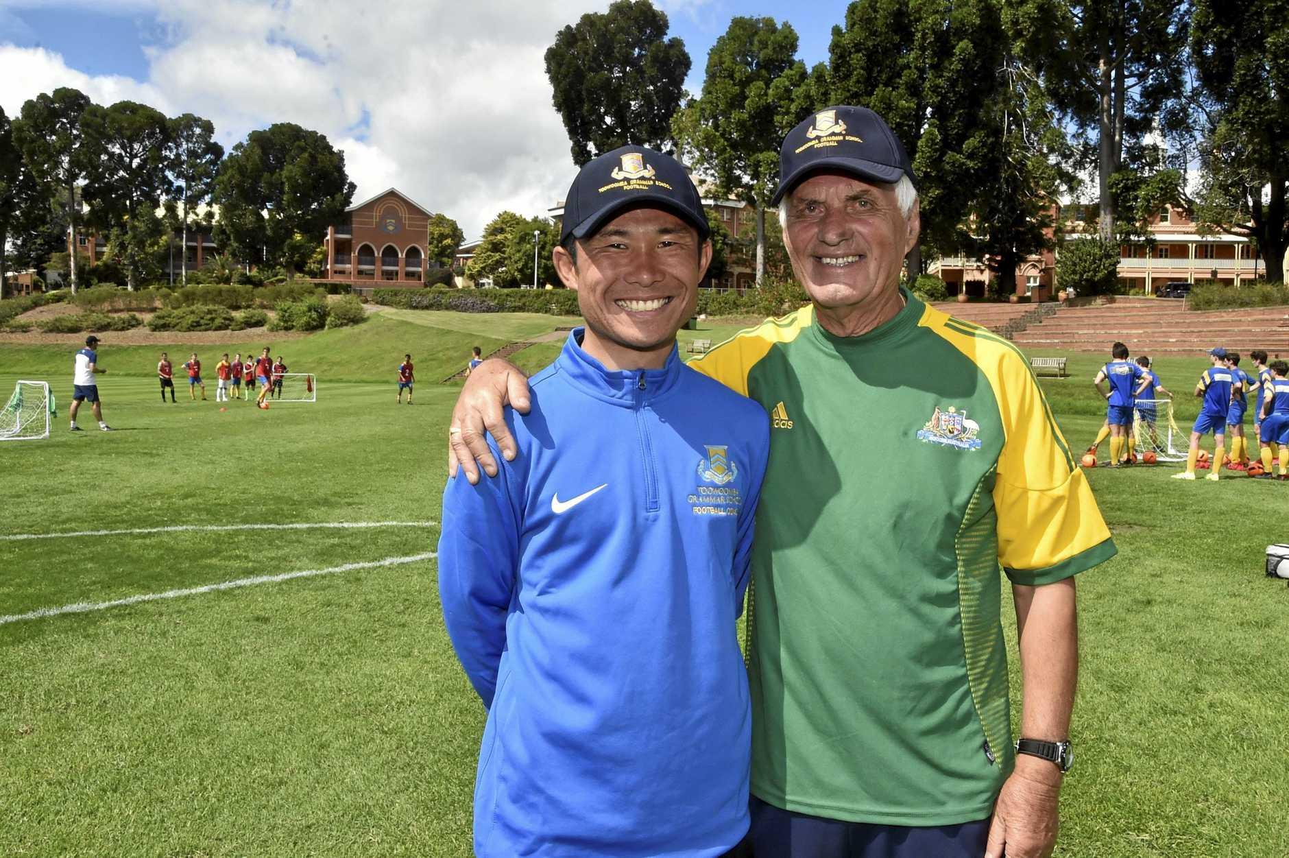 Hiroshi Imai and Rale Rasic talk football during the Toowoomba Grammar School clinic.