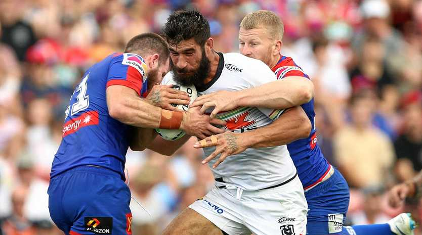 The Panthers' James Tamou is tackled by the Knights' defence in their round-two encounter. Picture: Brendon Thorne/AAP