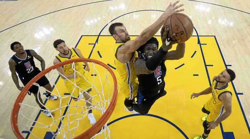 Los Angeles forward Montrezl Harrell shoots under Golden State centre Andrew Bogut during game two of their first-round NBA basketball play-off series in Oakland, California. Picture: Kyle Terada/AP