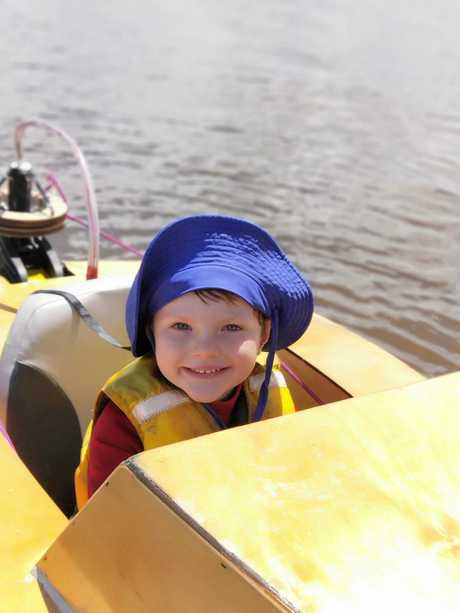 Elliott Gobus, 5, takes the mini homemade boat for a spin on Lake Tinaroo