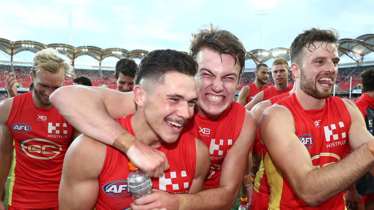 Suns celebrate after edging out Carlton in Round 4. (Photo by Chris Hyde)