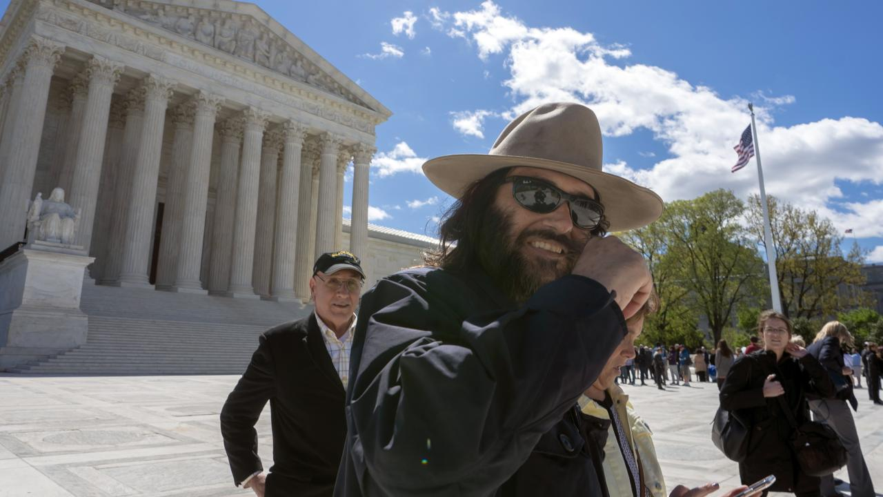 "Los Angeles artist Erik Brunetti, the founder of the streetwear clothing company ""FUCT,"" leaves the Supreme Court after his trademark case was argued in Washington on Monday, 15 April 2019. Picture: J. Scott Applewhite/AP"