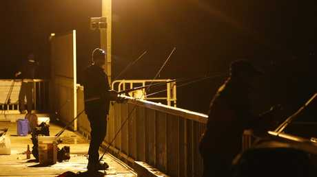 Fishermen at the Southport sand pumping jetty on Wednesday night. Photo: Jerad Williams