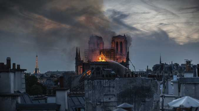 Flames and smoke are seen billowing from the roof at Notre-Dame Cathedral, as the first images of inside the building. Picture: Veronique de Viguerie/Getty Images.