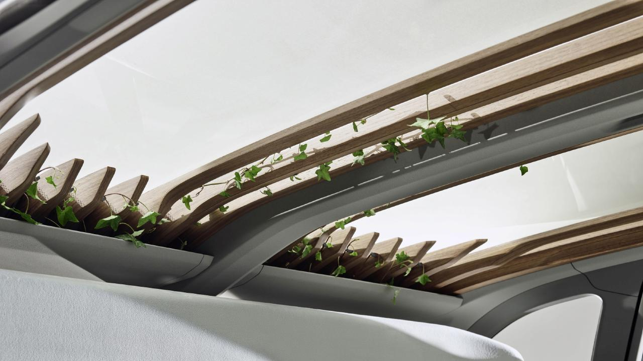 Audi AI:ME concept has wooden slates in the rood that act like pergola.